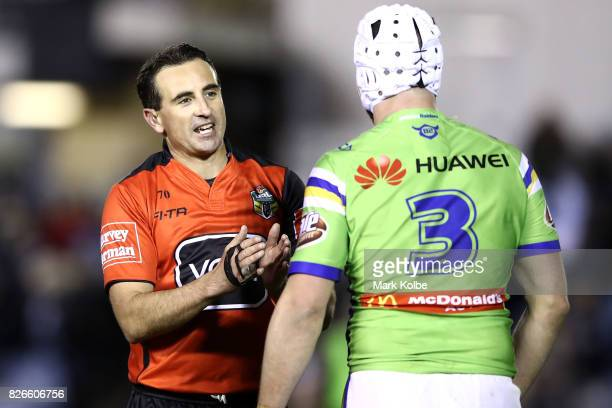 Referee Gerard Sutton speaks to Jarrod Croker of the Raiders during the round 22 NRL match between the Cronulla Sharks and the Canberra Raiders at...