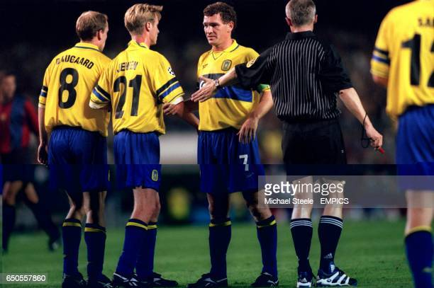 Referee Gerd Grabher makes sure that the Brondby wall Kim Daugaard Mikkel Jensen and John Jensen are back ten yards
