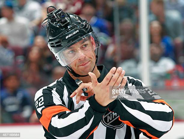 Referee Ghislain Hebert wears a video camera on his helmet during the NHL game between the Vancouver Canucks and the Edmonton Oilers at Rogers Arena...