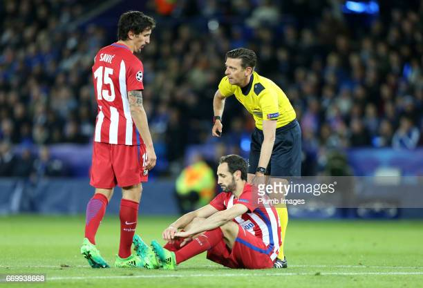 Referee Gianluca Rocchi checks on Diego Godin of Atletico Madrid during the UEFA Champions League Quarter Final Second Leg match between Leicester...
