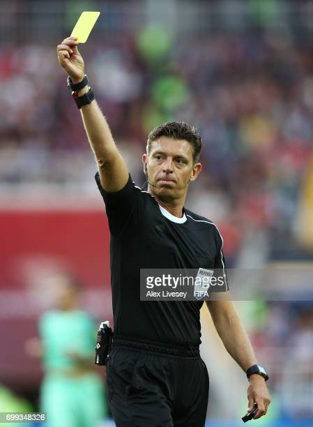 Referee Gianluca Rocchi displays a yellow card during the FIFA Confederations Cup Russia 2017 Group A match between Russia and Portugal at Spartak...