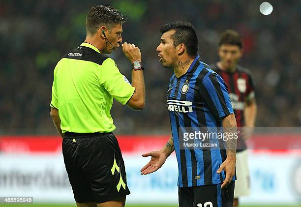 Referee Gianluca Rocchi disputes with Gary Alexis Medel of FC Internazionale Milano during the Serie A match between FC Internazionale Milano and AC...