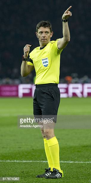Referee Gianluca Rocchi gestures during the friendly football match between Germany and England in Berlin Olympic Stadium in Berlin Germany on March...