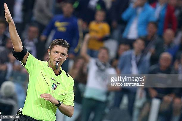 Referee Gianluca Rocchi gestures during the Italian Serie A football match between Juventus and Roma on October 5 2014 at Juventus Stadium in Turin...