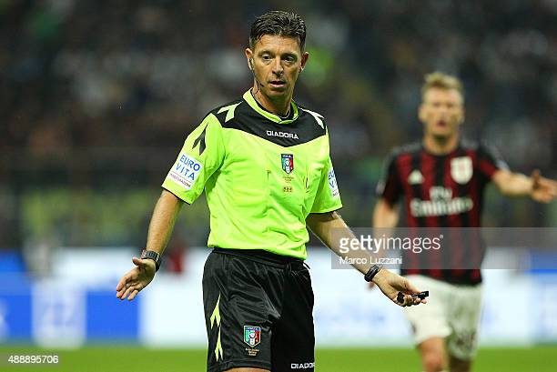 Referee Gianluca Rocchi gestures during the Serie A match between FC Internazionale Milano and AC Milan at Stadio Giuseppe Meazza on September 13...