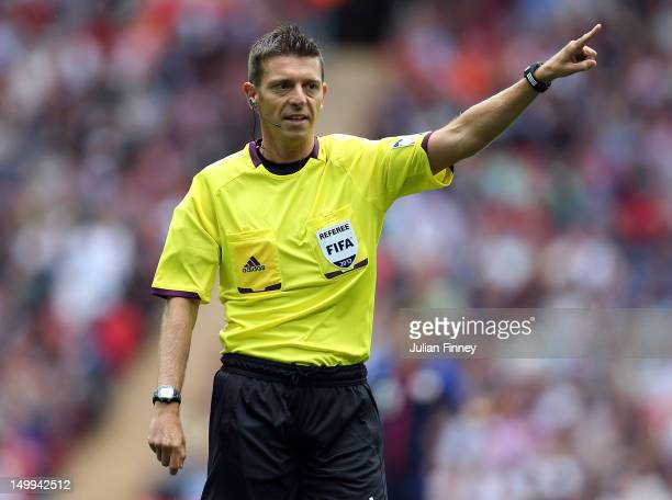 Referee Gianluca Rocchi gives a decision during the Men's Football Semi Final match between Mexico and Japan on Day 11 of the London 2012 Olympic...