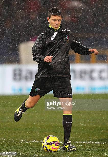 Referee Gianluca Rocchi kicks a ball before the Serie A match between UC Sampdoria and Genoa CFC suspended because of heavy rainfall at Stadio Luigi...