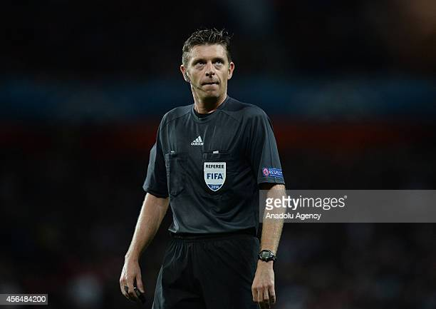 Referee Gianluca Rocchi looks on during the UEFA Champions League Group D football match between Arsenal FC and Galatasaray AS at Emirates Stadium on...