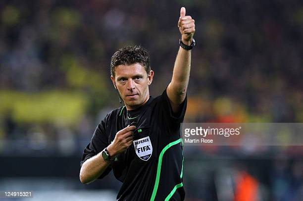 Referee Gianluca Rocchi of Italy gestures during the Champions League Group F match between Borussia Dortmund and Arsenal FC at Signal Iduna Park on...