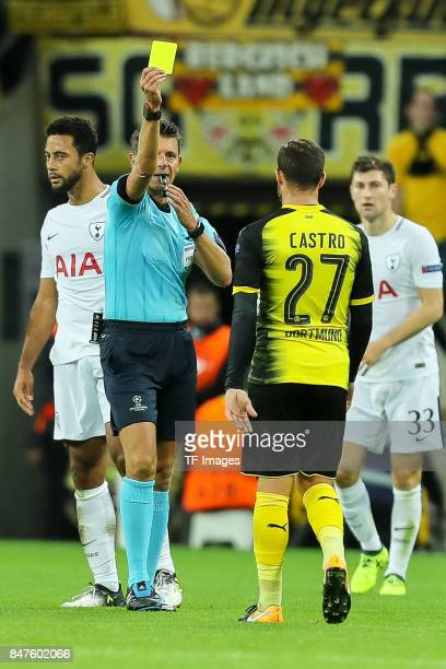 Referee Gianluca Rocchi show Gonzalo Castro of Dortmund the yellow card during the UEFA Champions League group H match between Tottenham Hotspur and...