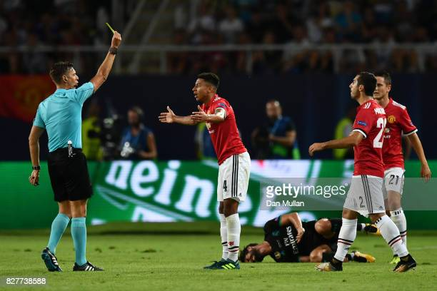 Referee Gianluca Rocchi shows Jesse Lingard of Manchester United a yellow card during the UEFA Super Cup final between Real Madrid and Manchester...