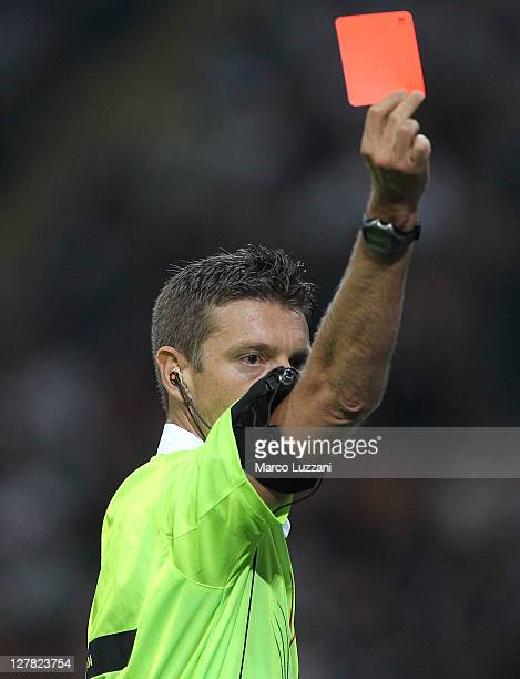 Referee Gianluca Rocchi shows the red card to Joel Obi of FC Internazionale Milano during the Serie A match between FC Internazionale Milano and SSC...