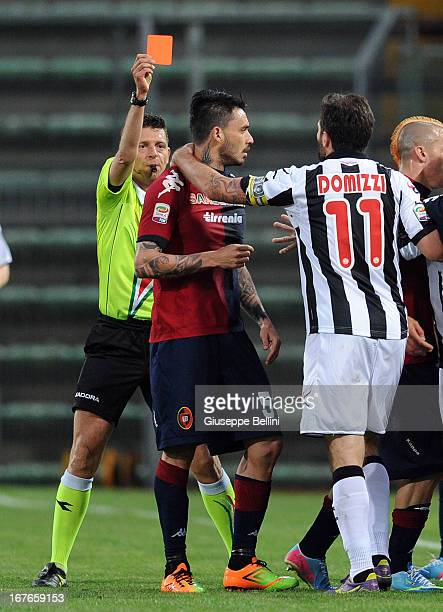 Referee Gianluca Rocchi shows the red card to Mauricio Pinilla of Cagliari the Serie A match between Cagliari Calcio and Udinese Calcio at Stadio...