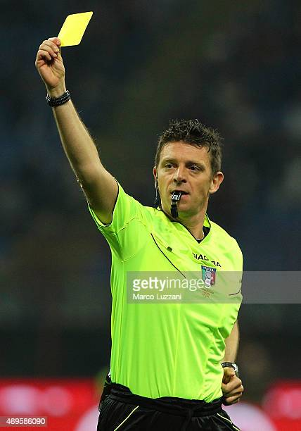 Referee Gianluca Rocchi shows the yellow card during the Serie A match between AC Milan and UC Sampdoria at Stadio Giuseppe Meazza on April 12 2015...