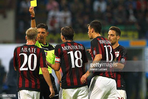 Referee Gianluca Rocchi shows the yellow card to Ignazio Abate of AC Milan during the Serie A match between FC Internazionale Milano and AC Milan at...