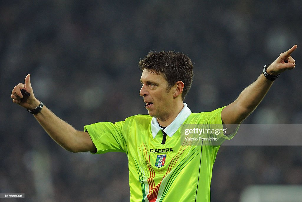 Referee Gianluca Rocchi signals a foul during the Serie A match between Juventus and Torino FC at Juventus Arena on December 1, 2012 in Turin, Italy.