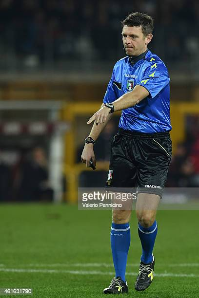 Referee Gianluca Rocchi signals a foul during the Serire A match between Torino FC and AC Milan at Stadio Olimpico di Torino on January 10 2015 in...