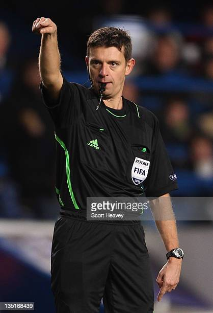 Referee Gianluca Rocchi signals during the UEFA Champions League Group E match between Chelsea FC and Valencia CF at Stamford Bridge on December 6...