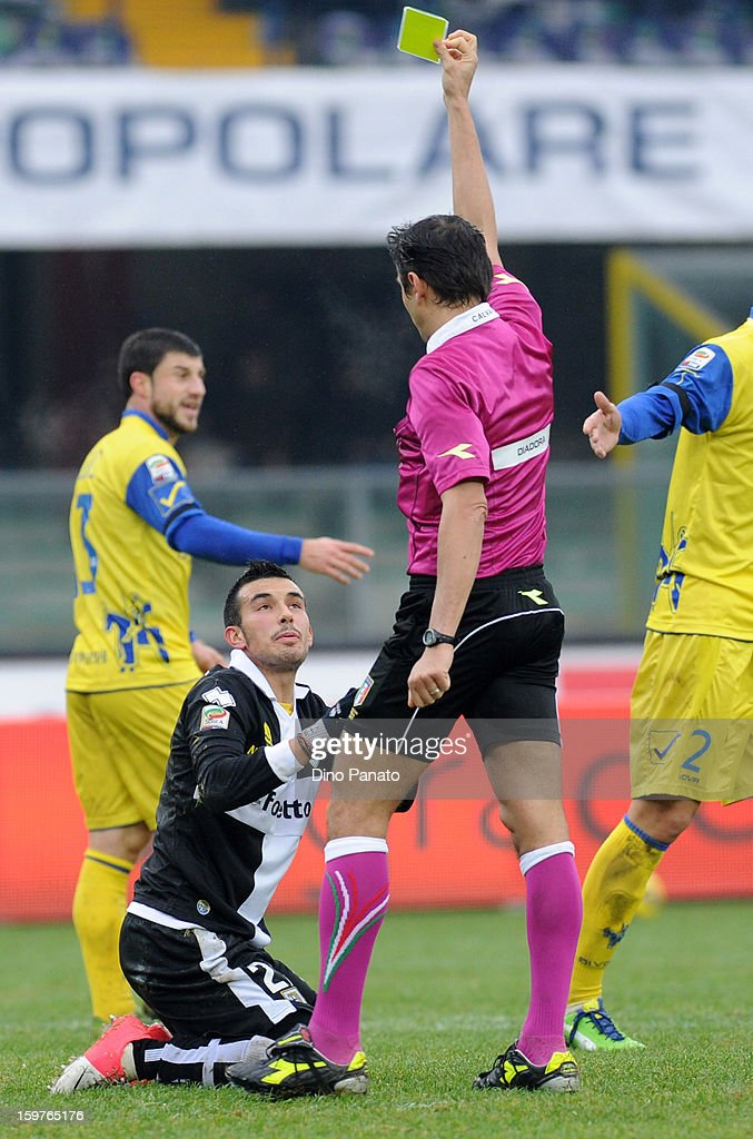 referee Gianpaolo Calvarese (R) show yellow card to Nicola Sansone of Parma FC during the Serie A match between AC Chievo Verona and Parma FC at Stadio Marc'Antonio Bentegodi on January 20, 2013 in Verona, Italy.