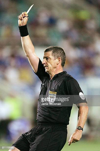 Referee Gilles Veissiere shows a yellow card during the UEFA Euro 2004 Group A match between Russia and Greece at the Algarve Stadium on June 20 2004...