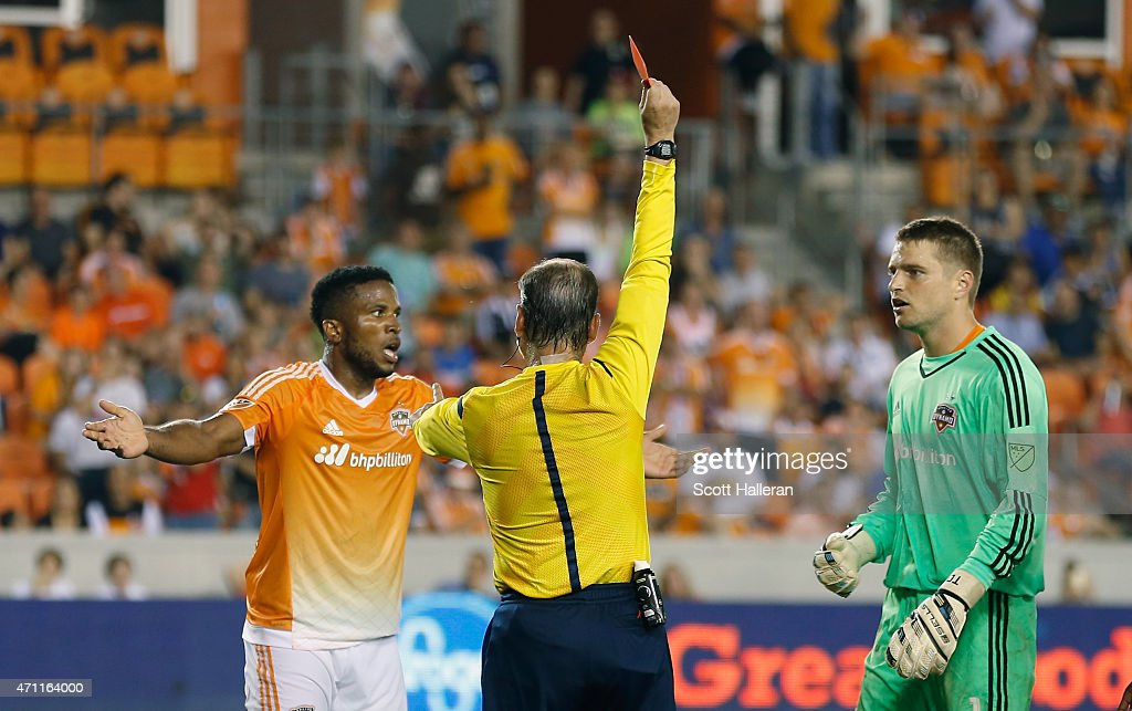MLS referee gives a red card to <a gi-track='captionPersonalityLinkClicked' href=/galleries/search?phrase=Jermaine+Taylor+-+Soccer+Player&family=editorial&specificpeople=13524207 ng-click='$event.stopPropagation()'>Jermaine Taylor</a> #4 of Houston Dynamo as keeper Tyler Deric #1 looks on during their game at BBVA Compass Stadium on April 25, 2015 in Houston, Texas.