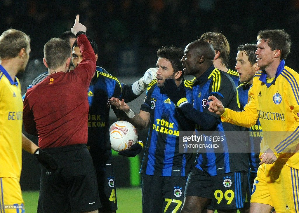A referee (2nd L) gives a red cart to Fenerbahce SK's Pierre Webo (partly seen 3rs L) during the round of 32 Europa League football match Fenerbahce SK against Bate Borisov at Neman Stadium in the Belarus town Grodno, some 300 km west of the capital Minsk on February 14, 2013.