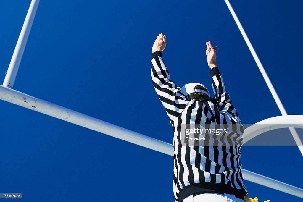 Referee giving signal for successful field goal