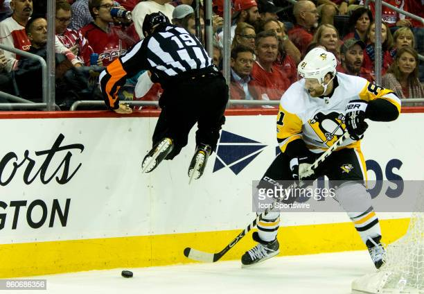 Referee Good Dwyer leaps out of the way of Pittsburgh Penguins right wing Phil Kessel during a NHL game between the Washington Capitals and the...