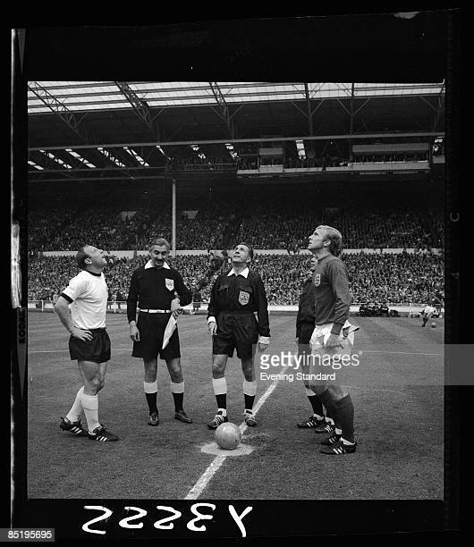 Referee Gottfried Dienst of Switzerland tosses the coin before the start of the World Cup final at Wembley between England and West Germany 30th July...