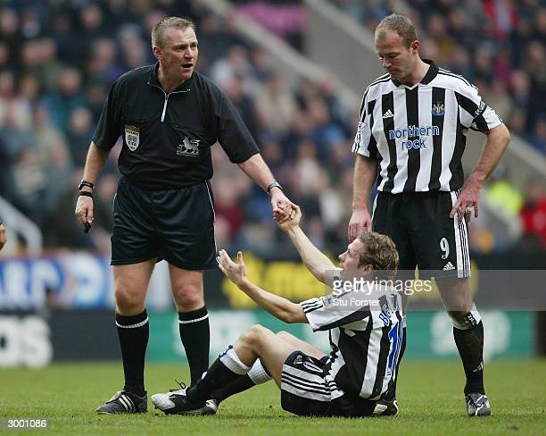 Referee Graham Poll gives Newcastle striker Craig Bellamy a helping hand during the FA Barclaycard Premiership match between Newcastle United and...