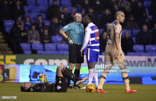 Referee Graham Scott has words with Reading's Nathaniel Chalobah after he collides with Leeds United goalkeeper Marco Silvestri