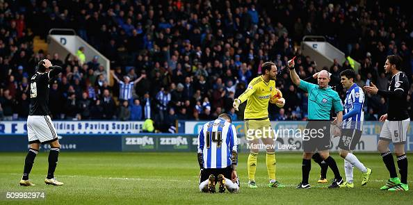 Referee Graham Scott sends off Yoann Barbet of Brentford after his challenge on Gary Hooper of Sheffield Wednesday during the Sky Bet Championship...