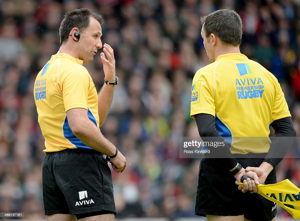 Referee, Greg Garner talks to his assistant prior to sending off Justin Melck of Saracens during the Aviva Premiership match between Leicester Tigers and Saracens at Welford Road on May 10, 2014 in Leicester, England.