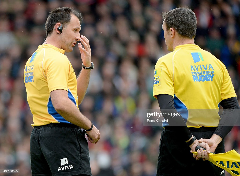 Referee, Greg Garner talks to his assistant Simon McConnell prior to sending off Justin Melck of Saracens during the Aviva Premiership match between Leicester Tigers and Saracens at Welford Road on May 10, 2014 in Leicester, England.