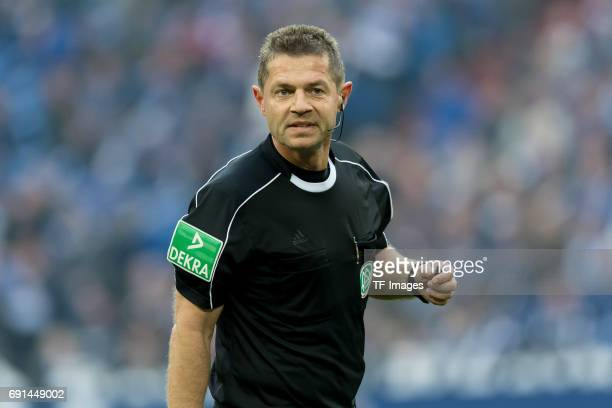 Referee Guenter Perl looks on during the Bundesliga match between FC Schalke 04 and RB Leipzig at VeltinsArena on April 23 2017 in Gelsenkirchen...