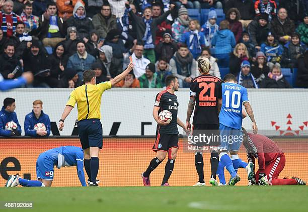 Referee Guenter Perl shows a red card to Goalkeeper Jaroslav Drobny of Hamburg during the Bundesliga match between 1899 Hoffenheim and Hamburger SV...