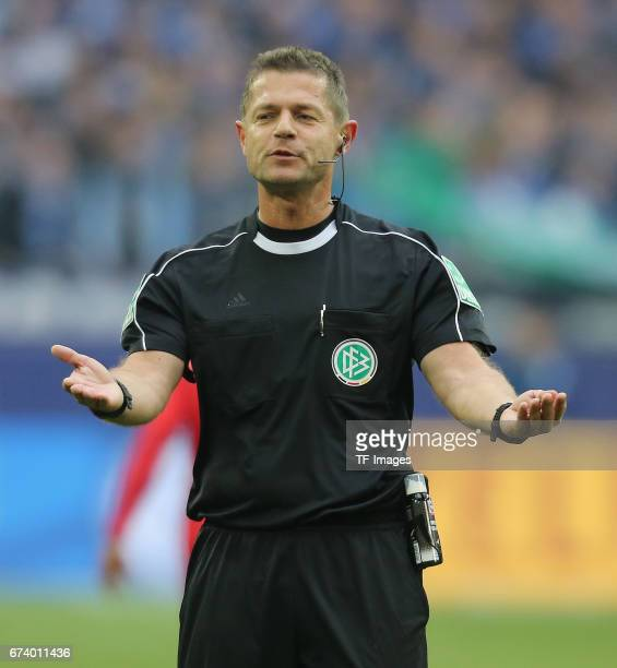 Referee Guenther Perl looks on during the Bundesliga match between FC Schalke 04 and RB Leipzig at VeltinsArena on April 23 2017 in Gelsenkirchen...