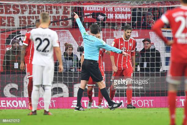 Referee Guido Winkelmann signals that the penalty has to be taken again during the Bundesliga match between FC Bayern Muenchen and Hannover 96 at...