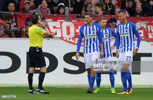 Referee Guido Winkmann Niklas Stark Mitchell Weiser and Davie Selke of Hertha BSC during the game between SC Freiburg and Hertha BSC on October 22...