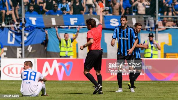 Referee Guido Winkmann shows Kevin Nennhuber of Mannheim the red card during the Third League playoff leg one match between Waldhof Mannheim and SV...