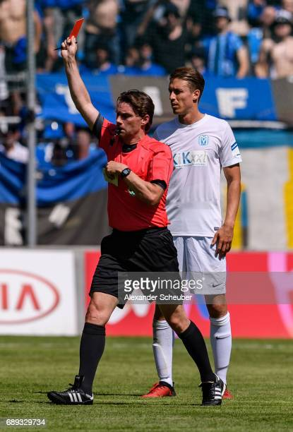 Referee Guido Winkmann shows Martin Wagner of Meppen the red card during the Third League playoff leg one match between Waldhof Mannheim and SV...