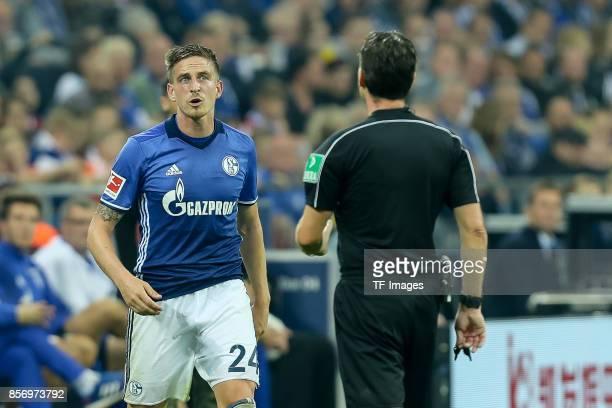Referee Guido Winkmann speak with Bastian Oczipka of Schalke during the Bundesliga match between FC Schalke 04 and Bayer 04 Leverkusen at...