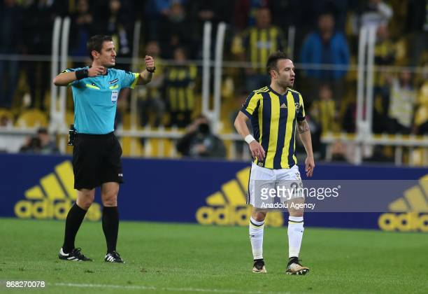 Referee Halil Umut Meler gives instructions over a request of jersey change for Mathieu Valbuena of Fenerbahce during a Turkish Super Lig match...