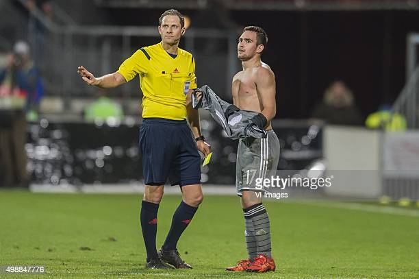 referee Harald Lechner waits till Andrija Zivkovic of FK Partizan has his shirt on to give him a yellow card during the UEFA Europa League match...