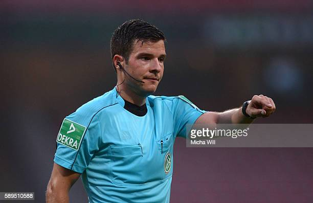 Referee Harm Oserms reacts during the Second Bundesliga match between 1 FC Nuernberg and 1 FC Heidenheim 1846 at Arena Nuernberg on August 12 2016 in...