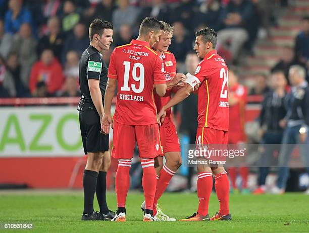 referee Harm Osmers Damir Kreilach Felix Kroos and Steven Skrzybski of 1 FC Union Berlin during the Second Bundesliga match between 1 FC Union Berlin...