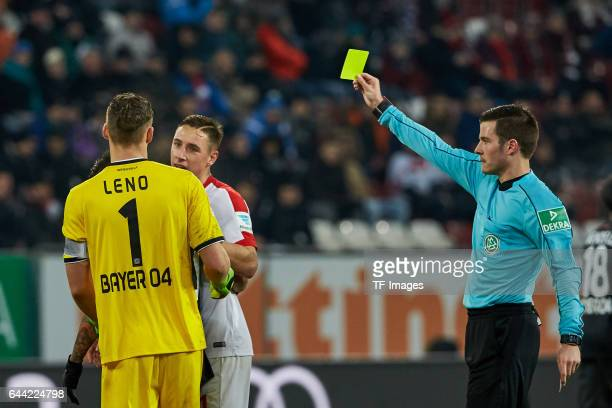 Referee Harm Osmers gievs Dominik Kohr of Augsburg the yellow card during the Bundesliga match between FC Augsburg and Bayer 04 Leverkusen at WWK...