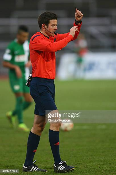 Referee Harm Osmers issues instructions during the 3 Liga match between Borussia Dortmund II and Preussen Muenster at Stadion Rote Erde on November...