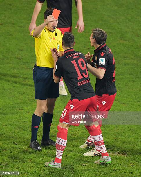 referee Harm Osmers shows Damir Kreilach of 1 FC Union Berlin die red card next to Michael Parensen of 1 FC Union Berlin during the game between...