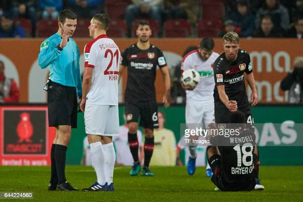 Referee Harm Osmers speak with Dominik Kohr of Augsburg during the Bundesliga match between FC Augsburg and Bayer 04 Leverkusen at WWK Arena on...